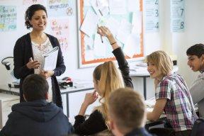 teacher teaching teens in class